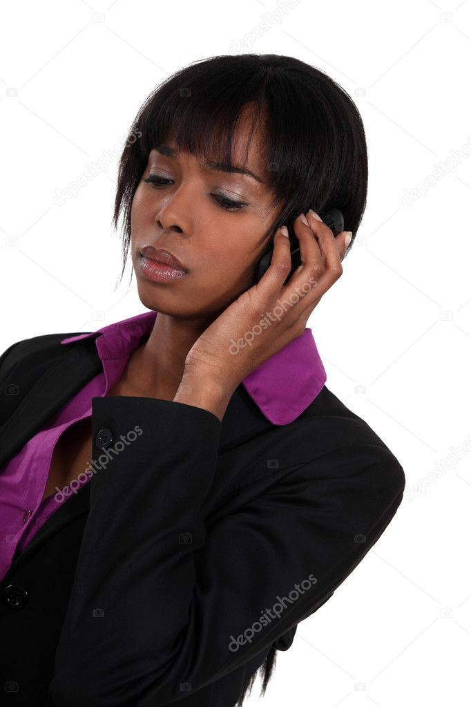 A sad businesswoman over the phone. — Stock Photo #7552418
