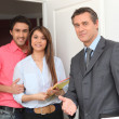 Young couple and realtor — Stock Photo