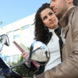Stock Photo: Urban couple on a moped