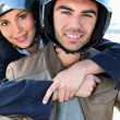 Couple on a scooter — Stock Photo #7607022