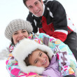 Family playing in the snow — Stock Photo #7607337