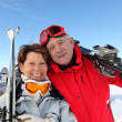 Stock Photo: Couple on ski slopes