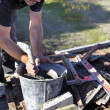 Stock Photo: Mason mixing cement