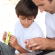Father and son fishing together — Stock Photo #7607500