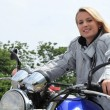 Woman on motor bike — Stockfoto