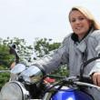 Woman on motor bike — Stock fotografie