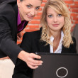 Businesswomen on laptop — Stock Photo #7607975