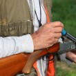 Hunter loading shotgun - Stock Photo
