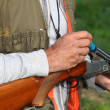 Hunter loading shotgun — Stock Photo