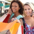 Pretty girlfriends doing shopping — Stock Photo