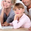 Family in front of laptop — Stock Photo