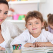 Stock Photo: Little girls drawing in class