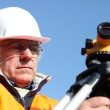 Mature surveyor in construction site — Stock Photo
