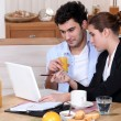 Woman going over a work presentation with her boyfriend during breakfast — Stock Photo #7608547