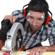 Man using circular saw to cut wood — Stock Photo #7608578