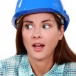 Royalty-Free Stock Photo: A portrait of a scared female construction worker.