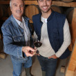 Smiling winegrowers in cellar — Stock Photo