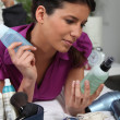 Portrait of a woman with cosmetics - Stock Photo