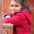 Cute little girl wearing a red coat - Photo