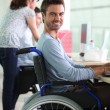 Stock Photo: Man in wheelchair at work