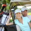 Couple in golf cart — Stock Photo #7608800