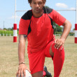 Rugby player kneeling — Stock Photo