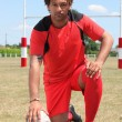 Rugby player kneeling — Stock Photo #7608850