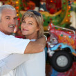 Middle-aged couple at funfair — Stock Photo #7608896