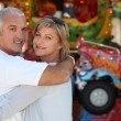 Stock Photo: Middle-aged couple at funfair