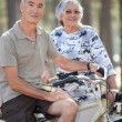 Stok fotoğraf: Old couple with bikes