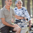 Stock Photo: Old couple with bikes