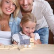 Stock Photo: Parents having fun with their little girl