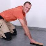 Man fitting new flooring — Stock Photo #7608930