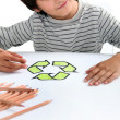 Boy colouring recycling logo — Stock Photo #7609725