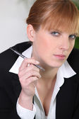 Businesswoman holding a pen — Stock Photo
