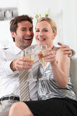 Couple with drinks — Stock Photo