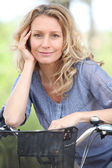 Woman on a bike — Stock Photo