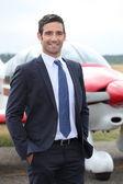 Pilot front his plane — Stock Photo