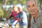 Three middle-aged on bike ride — Stock Photo