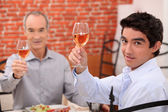 Men eating lunch in a restaurant — Stock Photo
