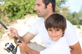 Father and son bonding during fishing trip — Stock Photo