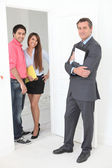 Estate agent with young couple — Stock Photo