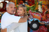 Middle-aged couple at funfair — Stock Photo