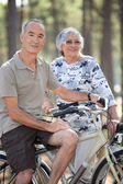 Old couple with bikes — Stok fotoğraf