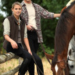Stock Photo: Young and horses