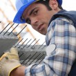 Stock Photo: Construction worker with slabs of reinforced concrete