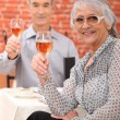 Elderly couple drinking wine in restaurant — Stock Photo