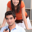 Stock Photo: Young couple watching television