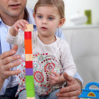 Father and daughter with building blocks — Stock Photo