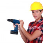 Tradeswoman holding a power tool — Stock Photo #7613148